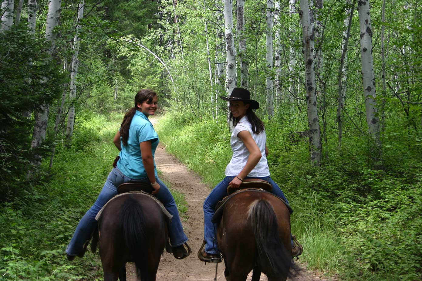 teen girls on horseback