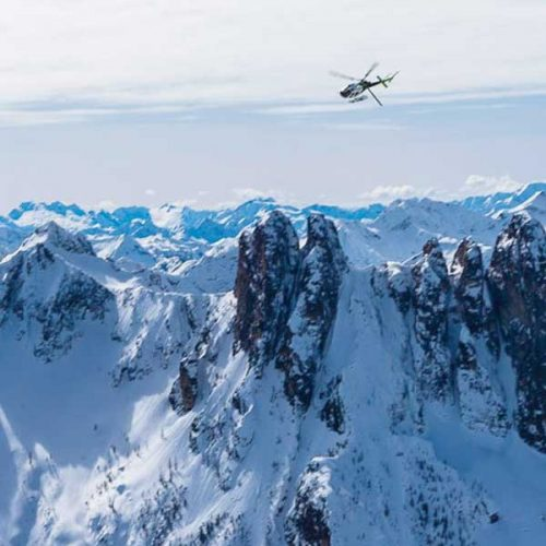 helicopter over snowy mountains