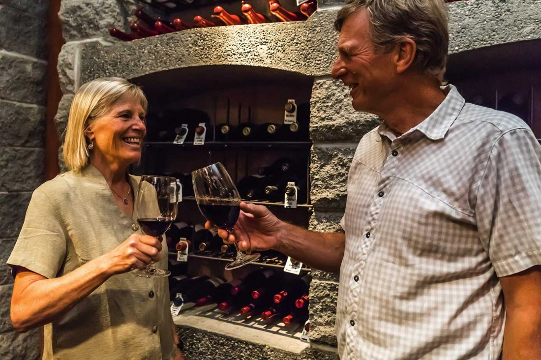 couple in wine cellar