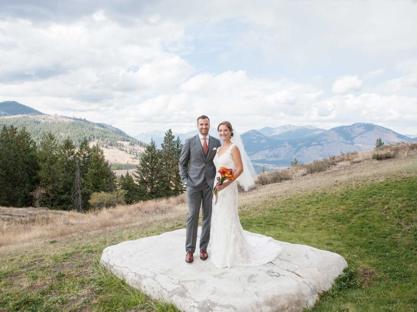 bride and groom on stone platform