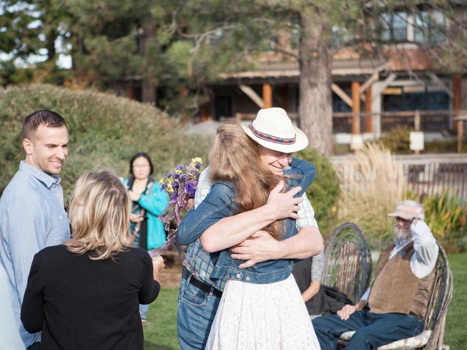 wedding goers hugging