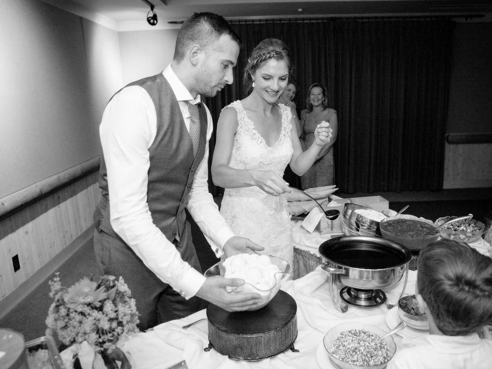 Mandy and Chris serving dessert