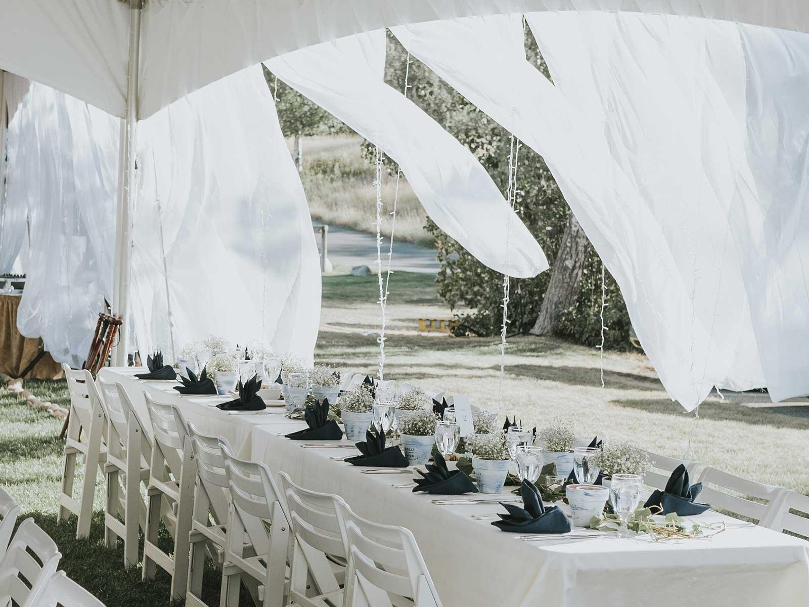 long banquet tables under tent