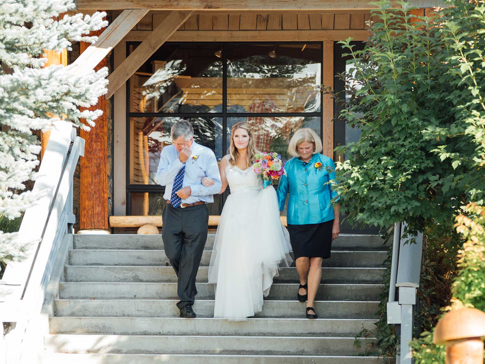 Bride and parents at the lodge